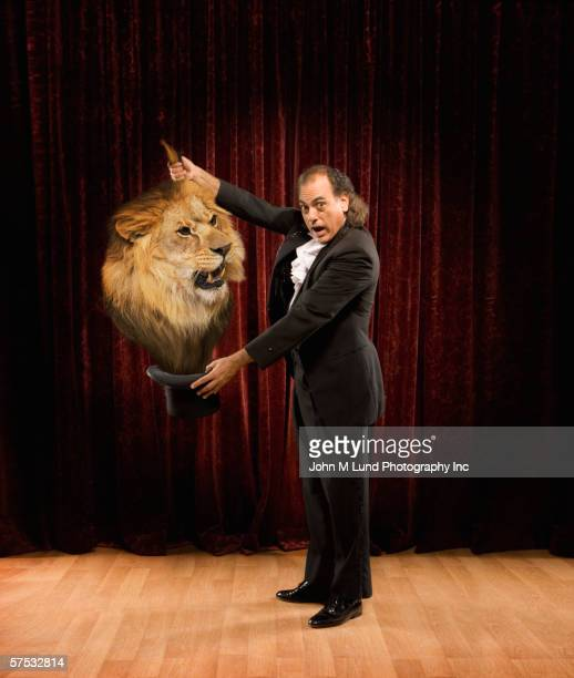 Magician pulling a lion out of a hat