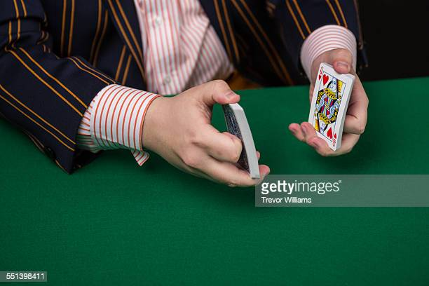 A magician shuffling some playing cards