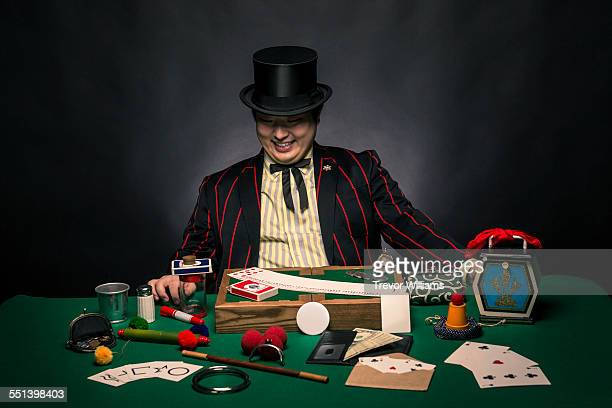 A magician sitting with his tricks