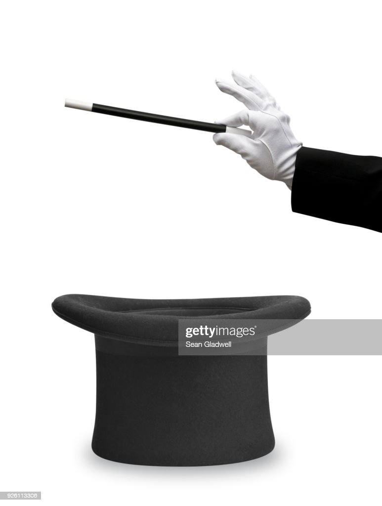 Magician wand and top hat : Stock Photo