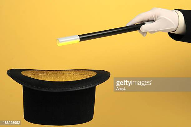 Magician Waving Wand over Glowing Top Hat