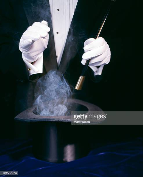 Magician with smoke in hat