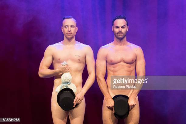 Magicians Christopher Wayne and Mike Tyler pose naked during a photocall for their show 'The Naked Magicians' at Assembly Rooms during the 70th...