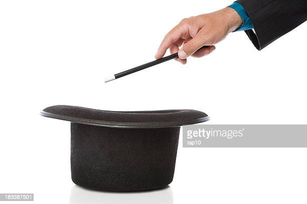 Magicians hat with magic wand waved over it