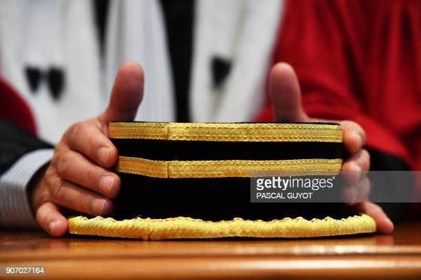 A magistrate holds his hat during the Appeal Court's solemn hearing to mark the beginning of the judicial year on January 19 2018 at the courthouse...