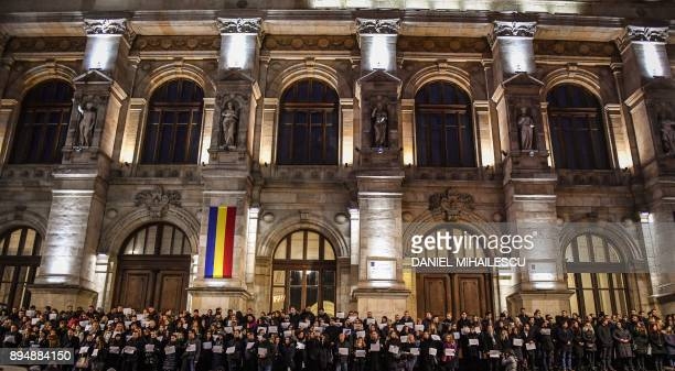 Magistrates stand in front of the Court of Appeal in Bucharest on December 18 as some 400 magistrates took part in a silent protest in support of the...
