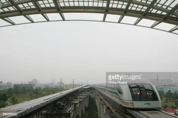 A Maglev train also known as the magnetic levitation train runs on a track on June 7 2005 in Shanghai China Shanghai boasts the world's only...