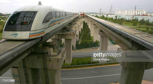 A maglev train approaches a station on July 24 2006 in Shanghai China According to state media released on June 9 China may abandon the construction...