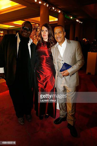 Magloire Pascal Legitimus and his wife Adriana Santini attend 20th edition of ' Les Sapins de Noel des Createurs' Designer's Christmas Trees Auction...