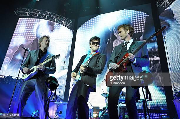 Magne Furuholmen Morten Harket and Pal Waaktaar of AHa perform on stage at Wembley Arena on November 27 2010 in London England