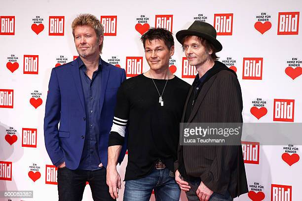 Magne Furuholmen Morten Harket and Pal WaaktaarSavoy of aha arrive for the Ein Herz Fuer Kinder Gala 2015 at Tempelhof Airport on December 5 2015 in...