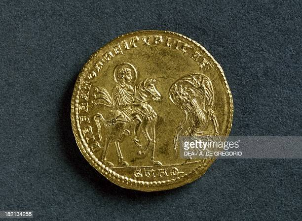Magnentius gold medallion depicting the Emperor receiving homage from the Republic bowed before him. Roman coins, 4th century AD.