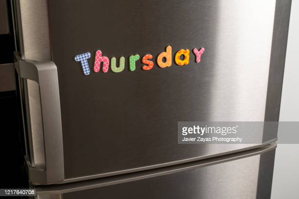 "magnetic letters forming the word ""thursday"" - 木曜日 ストックフォトと画像"