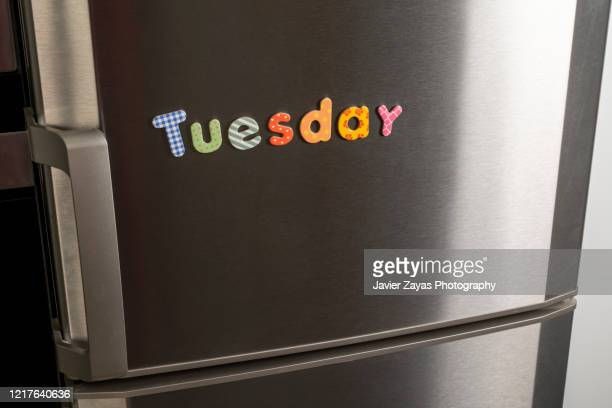 "magnetic letters forming the word ""tuesday"" - tuesday stock pictures, royalty-free photos & images"