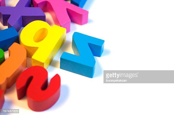 Magnetic letters on white background, close-up