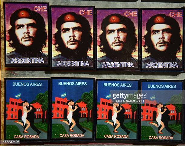 Magnets depicting revolutionary leader Argentineborn Ernesto 'Che' Guevara and tango dancers are displayed for sale at the street market of San Telmo...
