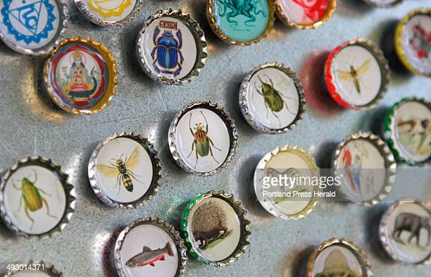 Magnets made with recycled bottle caps are displayed at the booth of Romona Beatrice during the Picnic Music Arts festival at Lincloln Park in...