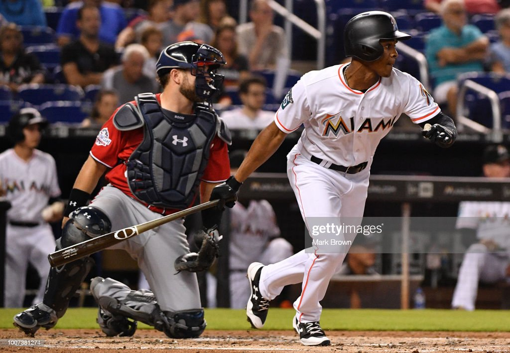 Magneuris Sierra #34 of the Miami Marlins singles in the second inning against the Washington Nationals at Marlins Park on July 29, 2018 in Miami, Florida.