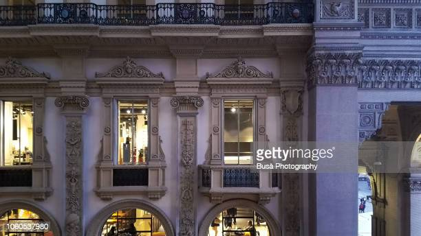 magnificent interiors of the shopping arcade galleria vittorio emanuele ii in piazza del duomo in milan, at twilight. milan, italy - physical description stock pictures, royalty-free photos & images
