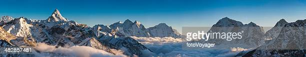 magnificent mountain panorama snowy peaks high above clouds himalayas nepal - mountain range stock pictures, royalty-free photos & images