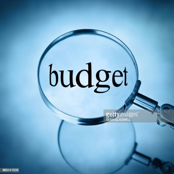 magnify budget - economy stock pictures, royalty-free photos & images