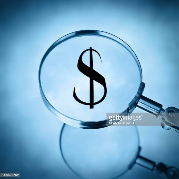 magnify dollar - bank icon stock photos and pictures