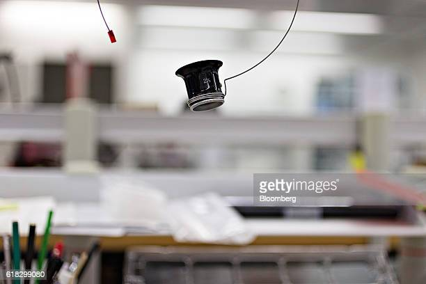 A magnifying eyepiece hangs mounted above a workstation in the wristwatch assembly room at the Mondaine Watch Ltd production facility in Solothurn...