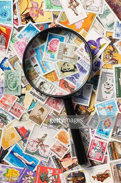 magnifying glass and stamps