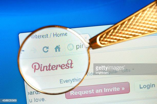 magnifying glass held over pinterest website - magnifying glass icon stock photos and pictures