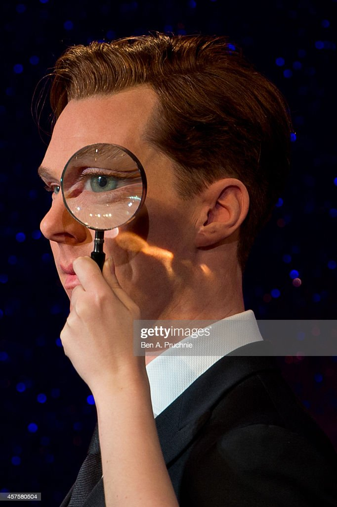 A magnifying glass is held over an eye as Madame Tussauds unveil new wax figure of Benedict Cumberbatch at Madame Tussauds on October 21, 2014 in London, England.