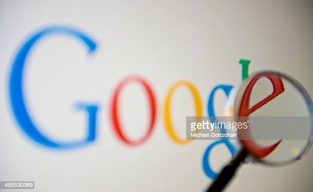 A magnifying glass is seen in front of a screen on which the Google search engine is displayed on June 02 2014 in Berlin Germany