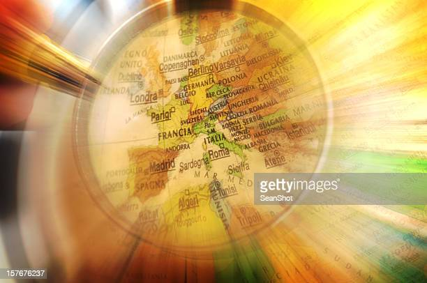 magnifying glass on a globe - zoom in stock photos and pictures