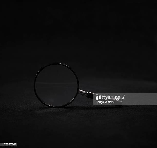 magnifying glass on black background. - magnifying glass stock pictures, royalty-free photos & images