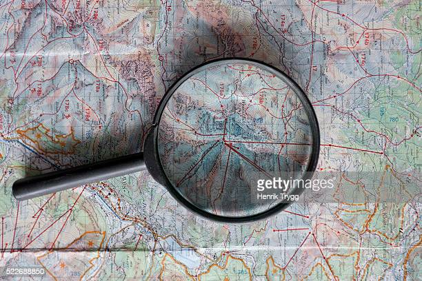 Magnifying glass on map
