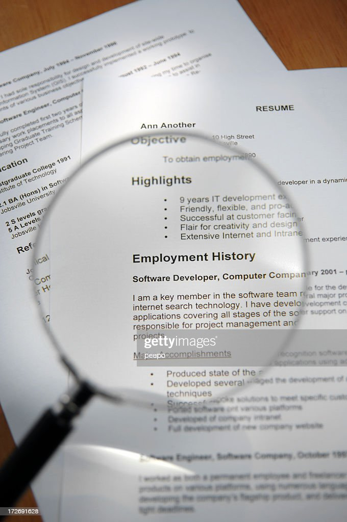 Magnifying Glass Over Resume : Stock Photo