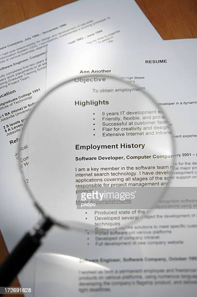 Magnifying Glass Over Resume