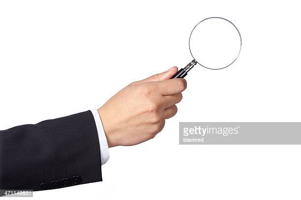 magnifying glass - long sleeved stock pictures, royalty-free photos & images