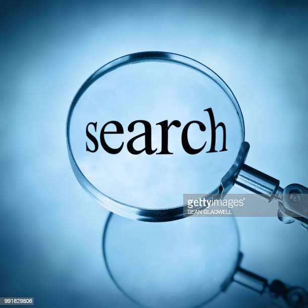 Magnifying glass with the word search magnified