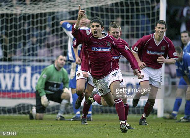 Magno Vieira of Northampton Town celebrates scoring the third goal of the match during the Nationwide League Division Three match between Northampton...