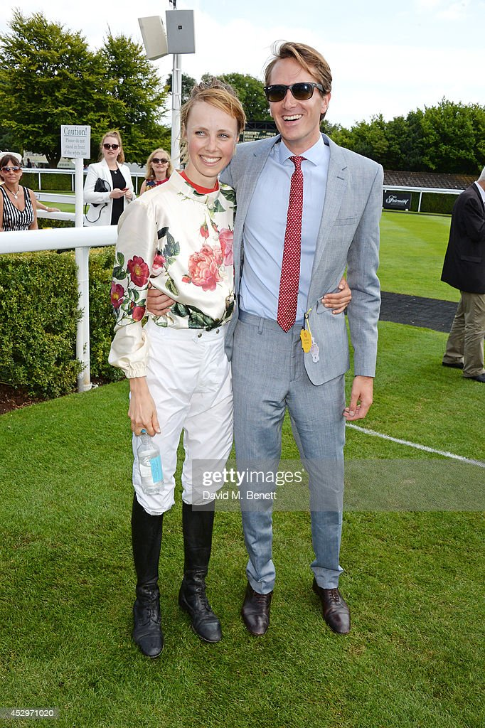 Magnolia Cup winner Edie Campbell (L) and Otis Ferry attend Glorious Goodwood Ladies Day at Goodwood on July 31, 2014 in Chichester, England.