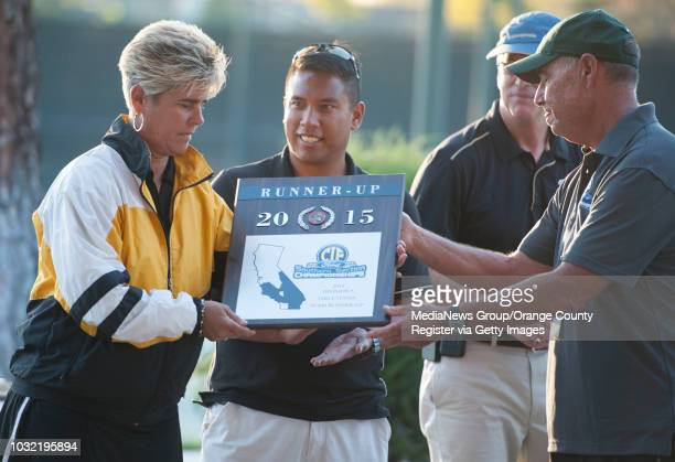 Magnolia head coach Anne Fumelle receives the second place plaque from committee member Brian Ricker after the girls tennis CIFSS Division 5...