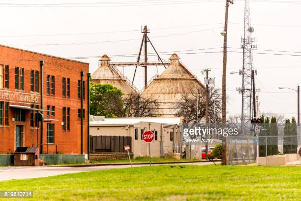 waco, tx, usa  march 18, 2017: magnolia silos in the distance as seen from one block away.. - waco stock pictures, royalty-free photos & images