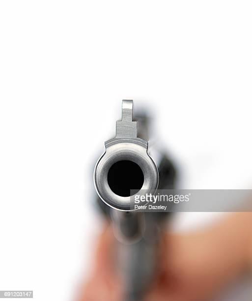 44 magnum gun pointing gun barrel at camera - gun barrel stock pictures, royalty-free photos & images