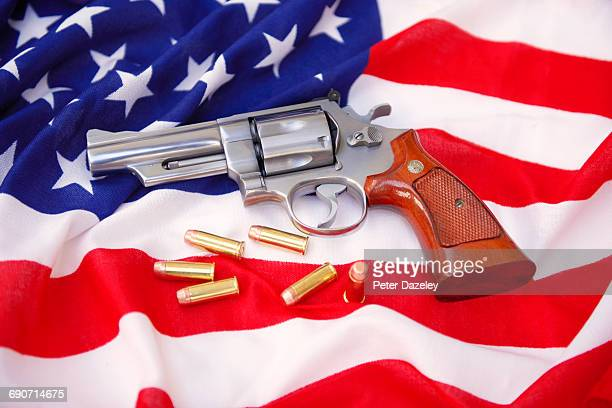 44 Magnum gun with bullets on US flag