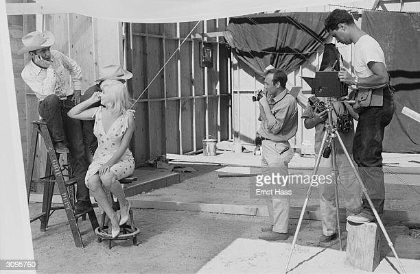 Magnum photographers Bruce Davidson and Elliott Erwitt set up a shot of Marilyn Monroe Clark Gable and Montgomery Clift on the set of 'The Misfits'...