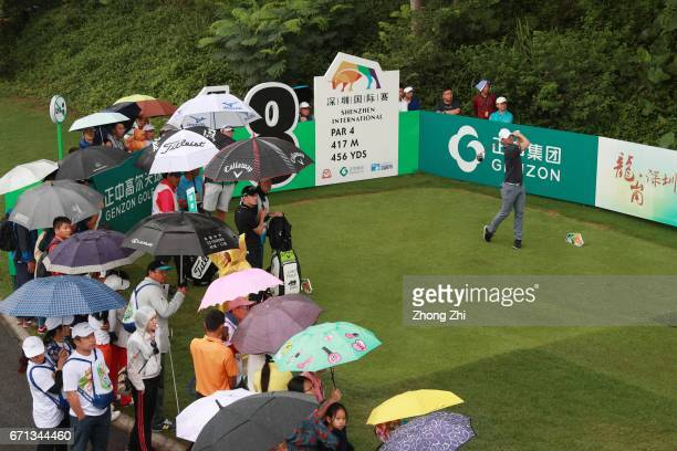 Magnus A Carlsson of Sweden of Portugal plays a shot while audience watch during the second round of the Shenzhen International at Genzon Golf Club...
