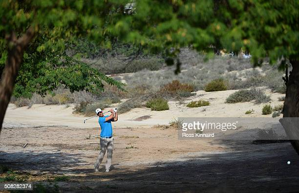 Magnus A Carlsson of Sweden plays a second shot on the third hole during the first round of the Omega Dubai Desert Classic at The Emirates Golf Club...