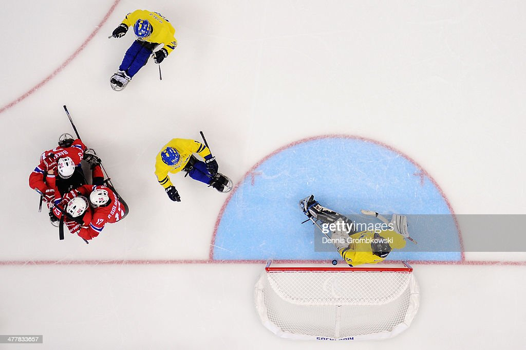 Magnus Bogle of Norway celebrates with team mates after scoring his team's first goal during the Ice Sledge Hockey Preliminary Round Group A match between Norway and Sweden during day four of Sochi 2014 Paralympic Winter Games at Shayba Arena on March 11, 2014 in Sochi, Russia.