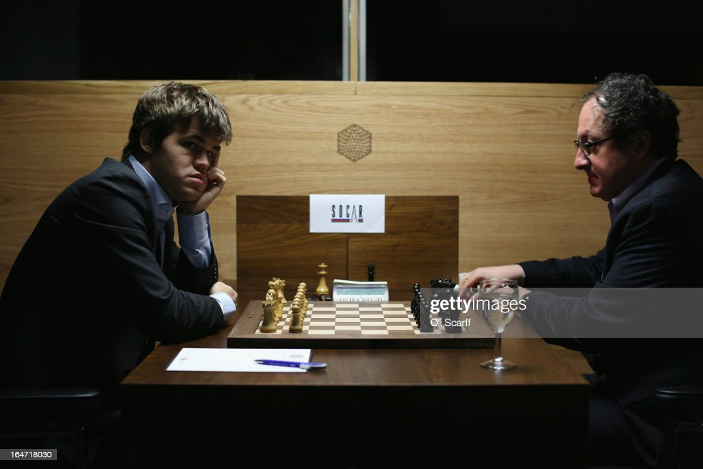 Magnus Carlsen (L), the world's number one chess player, prepares to play Israel's Boris Gelfand in the Candidates Tournament at the IET on Savoy Place on March 27, 2013 in London, England. Carlsen, 22, from Norway, became the youngest player to be ranked world No.1 on January 1, 2010 and his current chess ranking (a peak rating of 2872) is the highest of all time. The Candidates Tournament features eight of the world's top chess players and will determine which player will challenge Viswanathan Anand for the title of World Champion in November 2013. The tournament will be the strongest of its kind in history and have a total prize fund of 510,000 Euros.