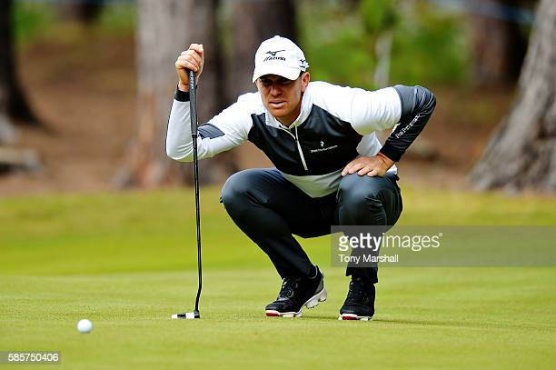 Magnus Carlsson of Sweden lines up a putt on the green on hole 3 on day one of the Aberdeen Asset Management Paul Lawrie Matchplay at Archerfield...